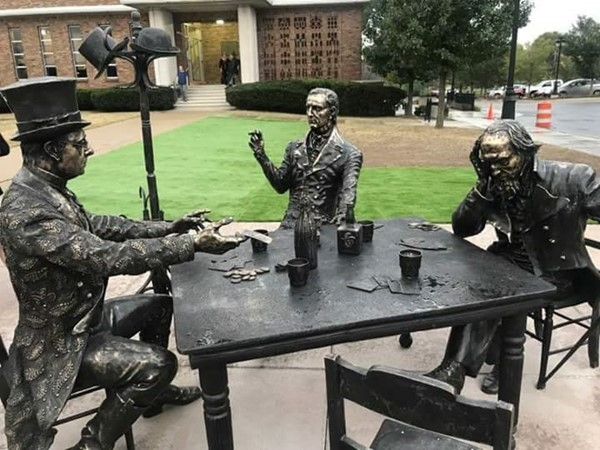 Sculpture depicts city fathers playing cards to win the rights to name the main streets of Fenton