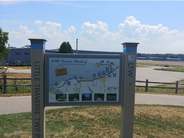 Ride the Little Traverse Wheelway to Harbor Springs! Stop at the park to watch private jets take off