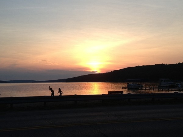 Playing in the dusk of a beautiful sunset over Walloon lake