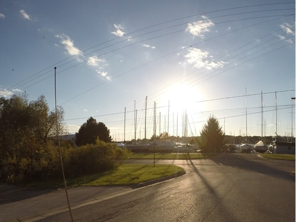 The bright sun over Whitehall Landing and Crosswinds Marina