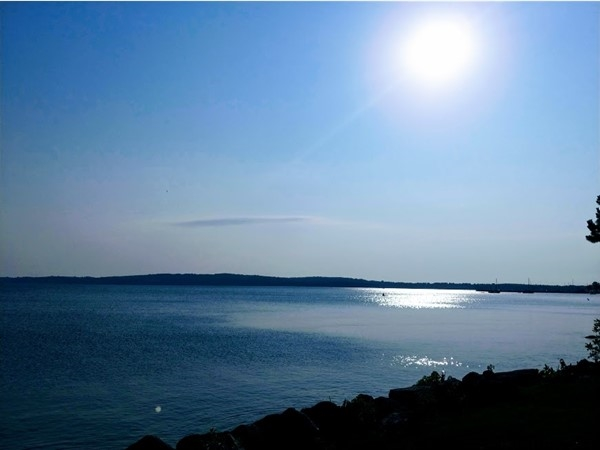 Ride the TART trail along West Grand Traverse Bay for a beautiful morning