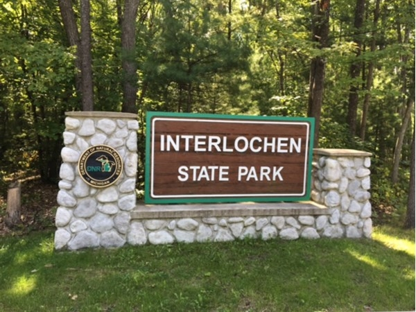 Interlochen State Park is home to miles of trails and a beautiful beach on Duck Lake