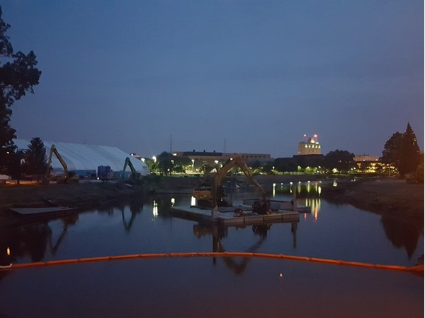 Night view of clean up on the Flint River
