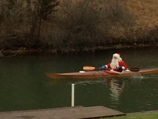 Here comes Santa kayaking down Gull Lake!