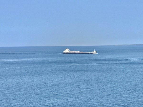Freighter travels between Mackinac Island and Bois Blanc Island