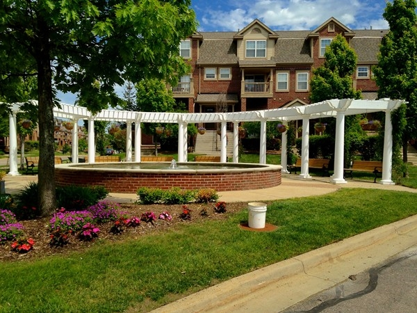 Attractive landscaping and pergola add to the beauty of this development