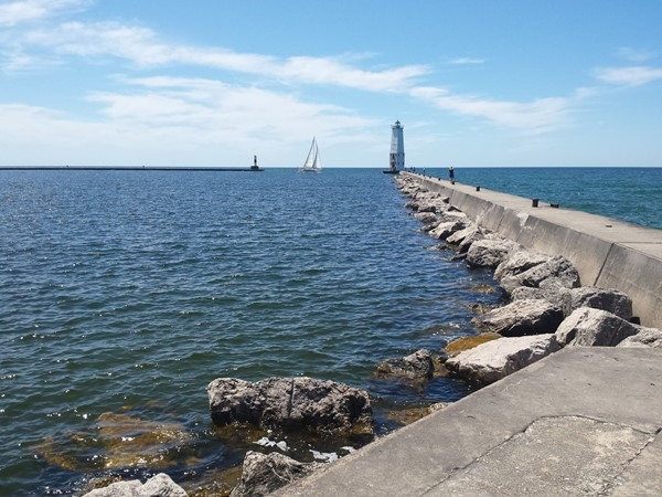 Walking the breakwater to the Frankfort Lighthouse
