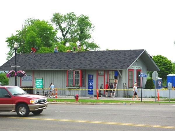 Volunteers re-roofing the White Lake Depot, our historic train station and Chamber of Commerce.