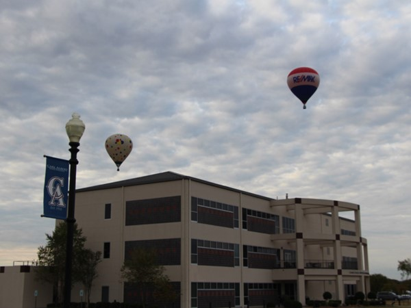 RE/MAX balloon rising above the crowd at Deanna Reed Science & Math Center at CASC