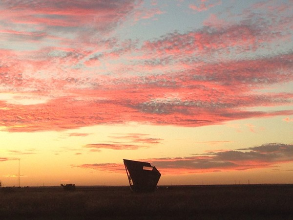 Altus sunset with a cotton stripper waiting for harvest