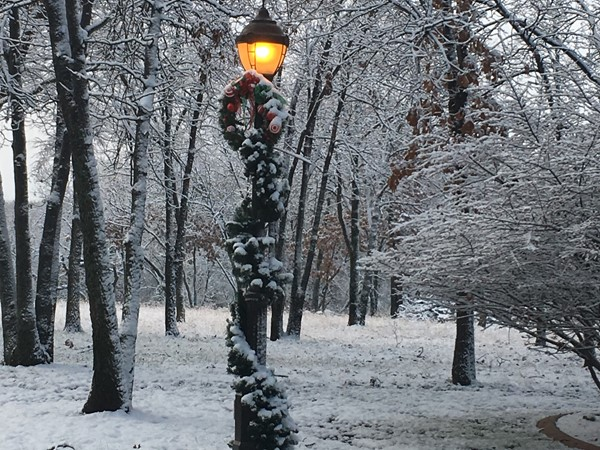 Decorated light post in Dover Pond ready for Christmas with snow and all