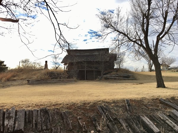 Hidden gems in the Foss Lake community! Check out this old log cabin and old chimney