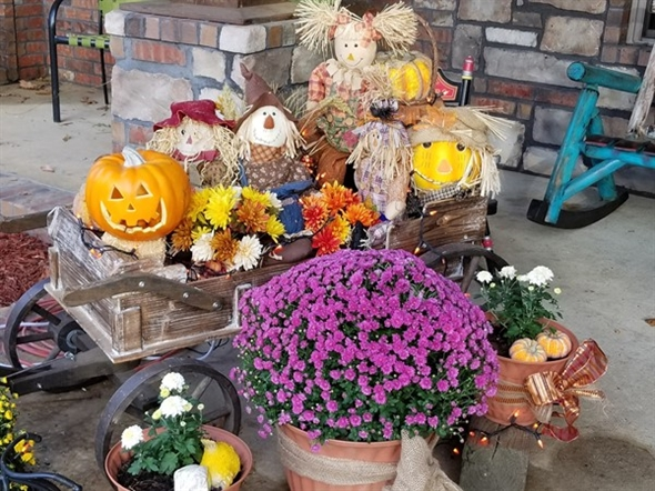 Fall is in the air!  Getting the mums and pumpkins set out on this beautiful day