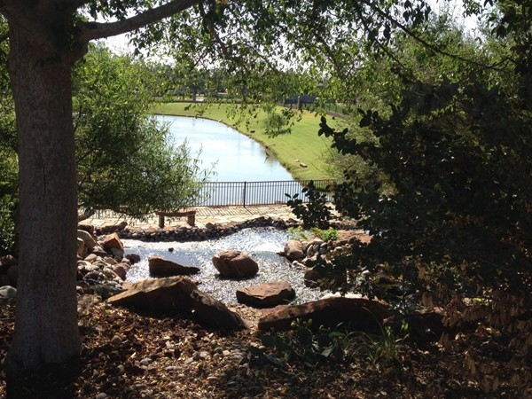 Lovely view of the large water feature is at the entrance to Highland Village