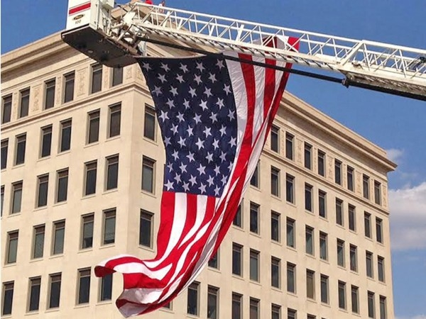 Enid's fire department rolled out the ladder to proudly display the flag during the Fireball Run