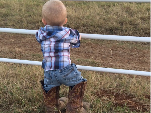 Starting them young on the ranch. Lil' farmer looking over the land in LeFlore County