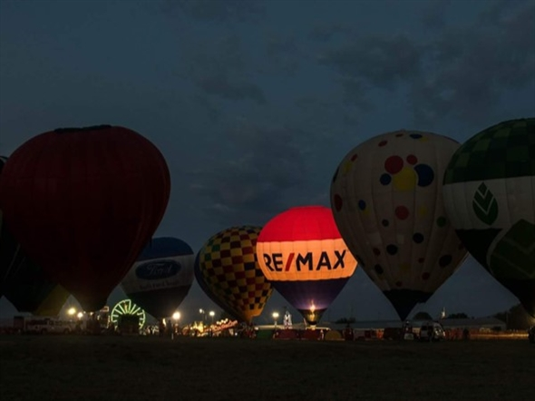 The RE/MAX hot air balloon is glowing during the Poteau Balloon Fest in Leflore County