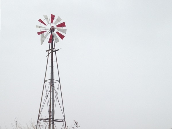 Beautiful windmill in the snow on a backroad near Ames