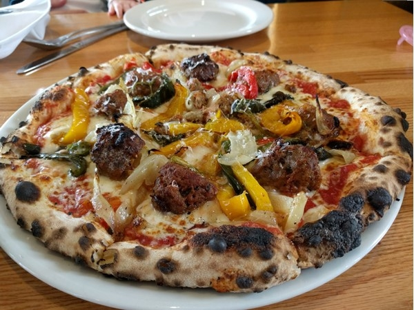 Pizzeria Gusto is located near the Paseo Arts District