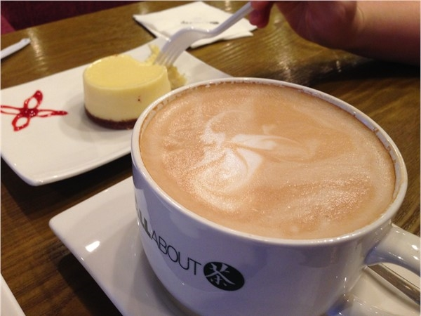 Enjoy a delicious latte and cheese cake at All About Cha