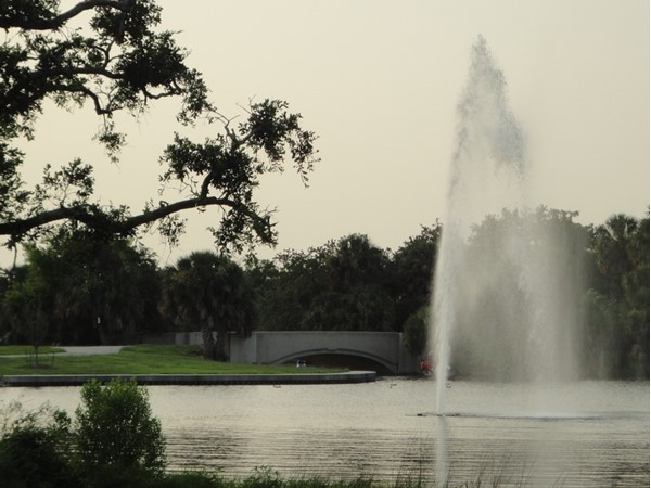 A popular walking path winds around this lake in City Park, past flower gardens and sculptures