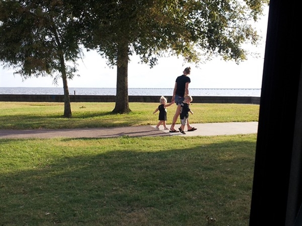 Mama Saints fan with baby Saints fans out for a Northshore stroll