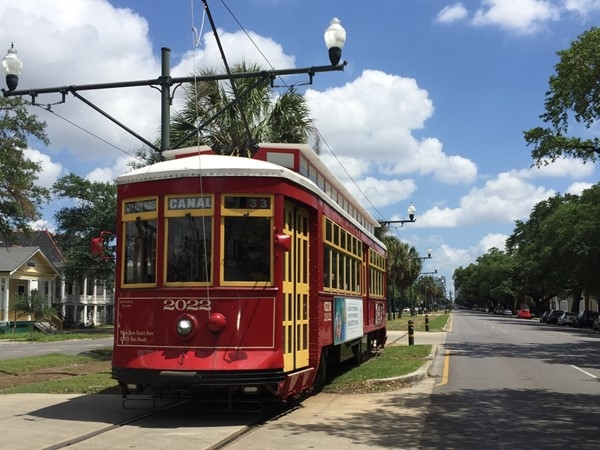 Iconic red Canal Streetcar runs through mid-city from the CBD to City Park and the cemeteries