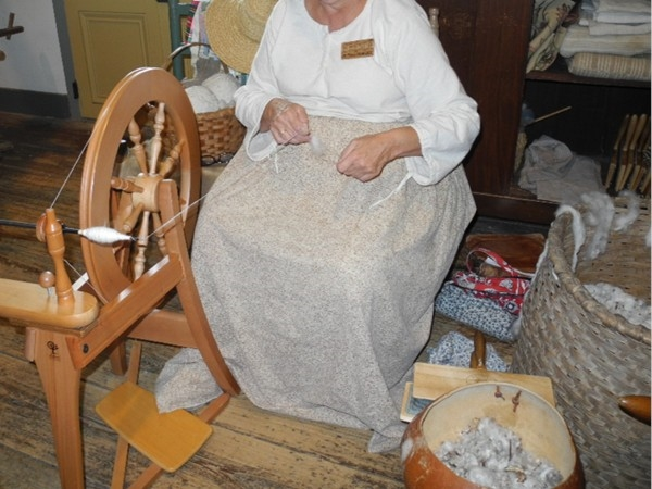 Spinning cotton into thread at the Vermilionville history museum and folklife park