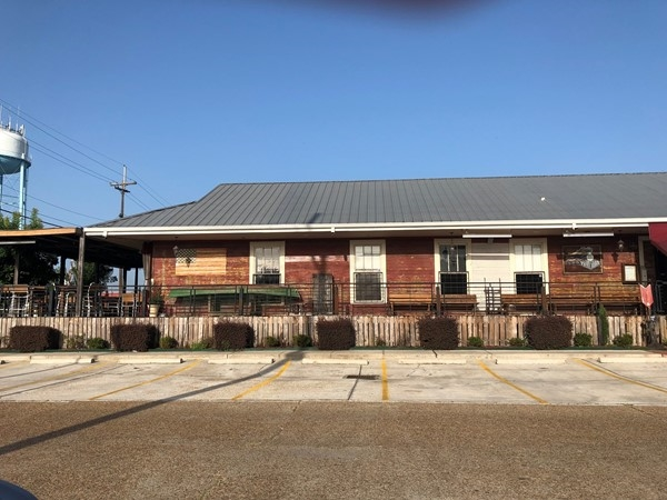 Dine alongside the railroad tracks at Cate Street Seafood Station in downtown Hammond