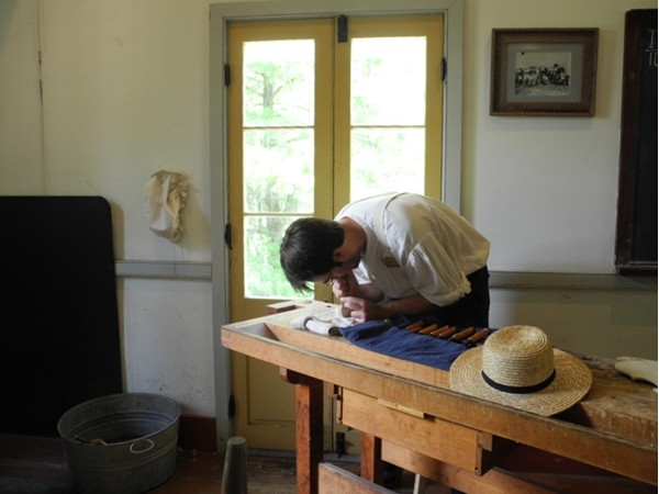 Carving the bow of a violin at the Vermilionville history museum and folklife park