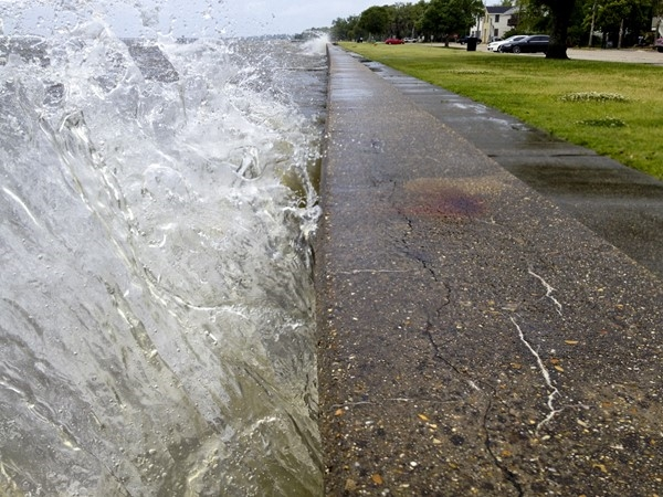 Waves crashing against the bulkhead that protects the park along Lakeshore Drive