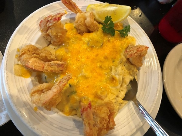 Omg!! So delicious! Seafood stuffed baked potato from Dempsey's in Prairieville