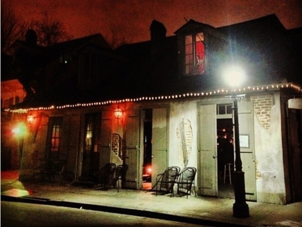 Nighttime view of historic Lafitte's Blacksmith Shop