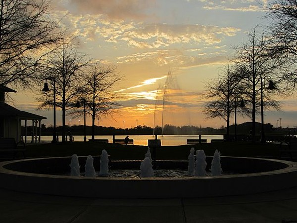 Amazing sunset view of fountains in Time Square of Sugar Mill Pond