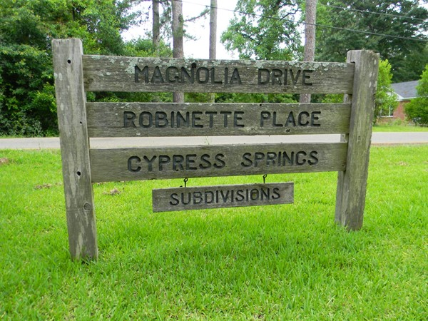 University Hills subdivisions include homes in Magnolia Drive, Robinette Place, & Cypress Springs.