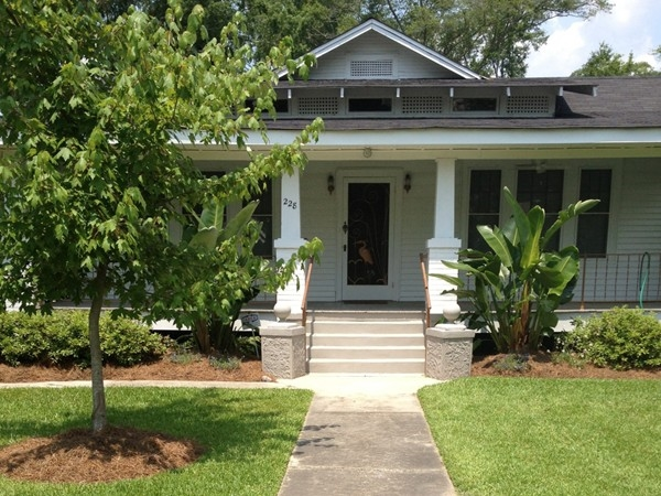 Much charm in this typical Old Mandeville home with it's breezy sprawling porches.