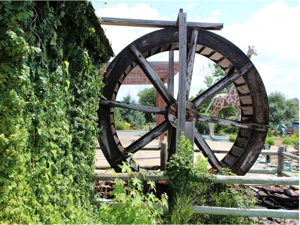 """The """"waterwheel"""" featured at Thomas Nursery & Feed is a reminder of """"days gone by"""""""