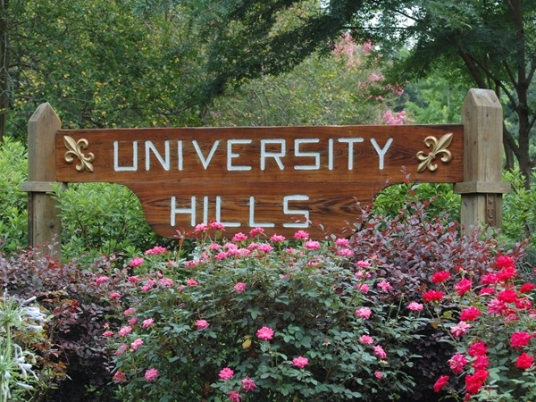 The entrance to University Hills is beautifully maintained
