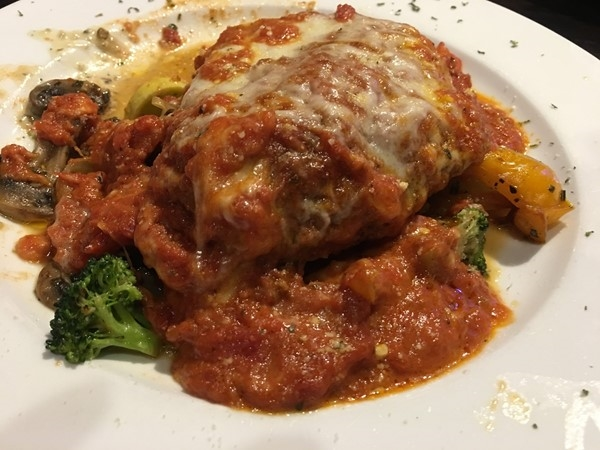 Chicken Parmesan from Fratelli's Italian Grille served over a variety of grilled vegetables