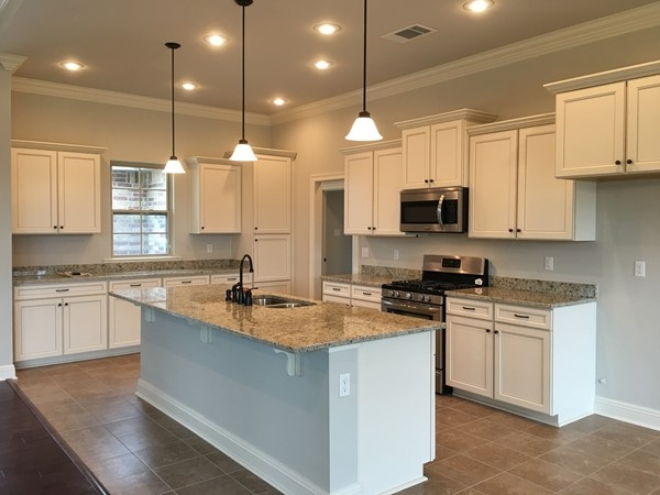Kitchens have stainless steel appliances and granite countertops