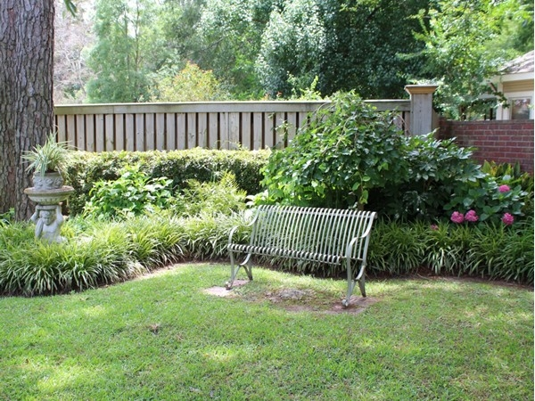 This quiet garden corner can be found in the luxurious neighborhood of Point Place