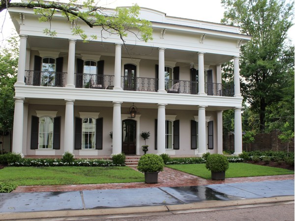 This gorgeous Southern-style antebellum home is part of exclusive Pargoud Place neighborhood