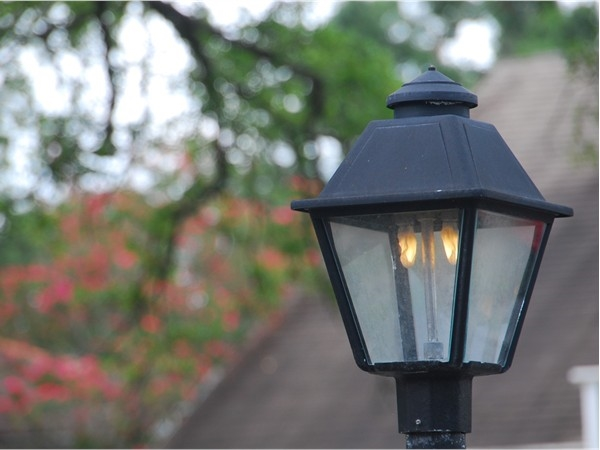 Gaslight lamps add a nostalgic touch to this area