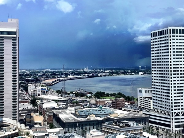 The high-rise buildings in the CBD are the best places to watch afternoon summer rainstorms