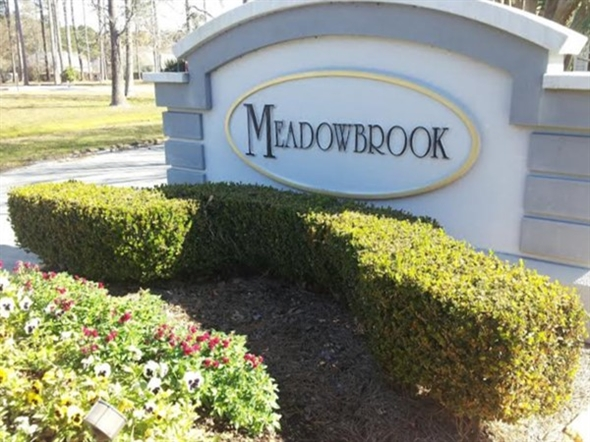 Dedicated entrance to Meadowbrook Subdivision on the Northshore