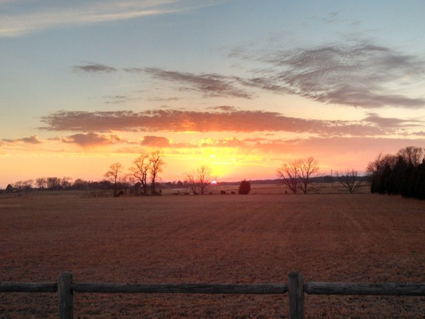 Gorgeous sunset over rolling acres of pasture