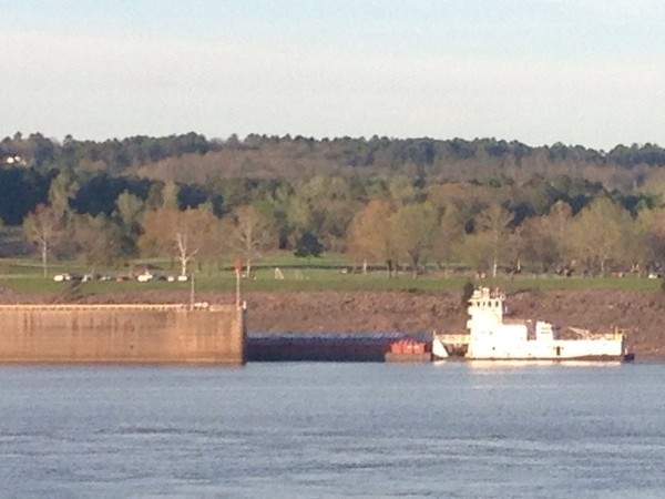 A barge being pushed through the Dardanelle Dam Lock