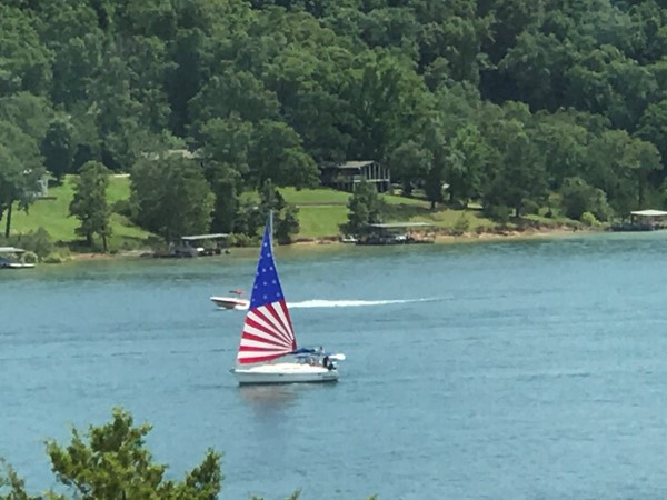 A colorful sailboat on Beaver Lake