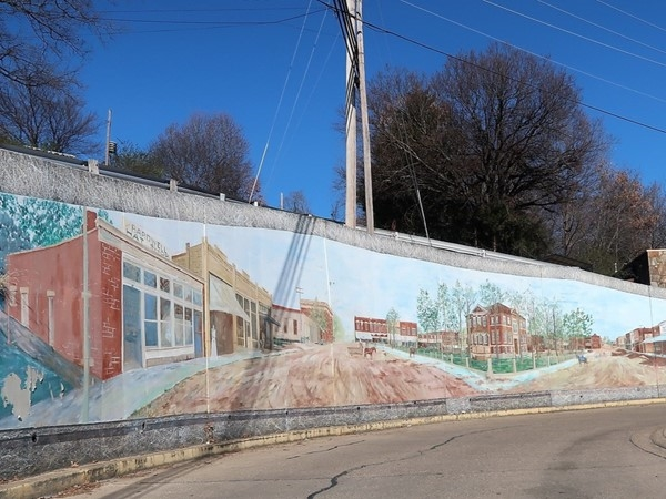 Harrison murals cornering North Spring and North Rush streets near the downtown square