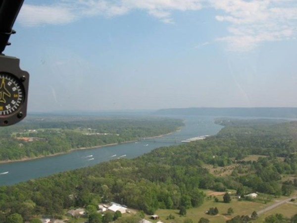 View from helicopter of boat races on Greers Ferry Lake. Narrows Bridge in distance